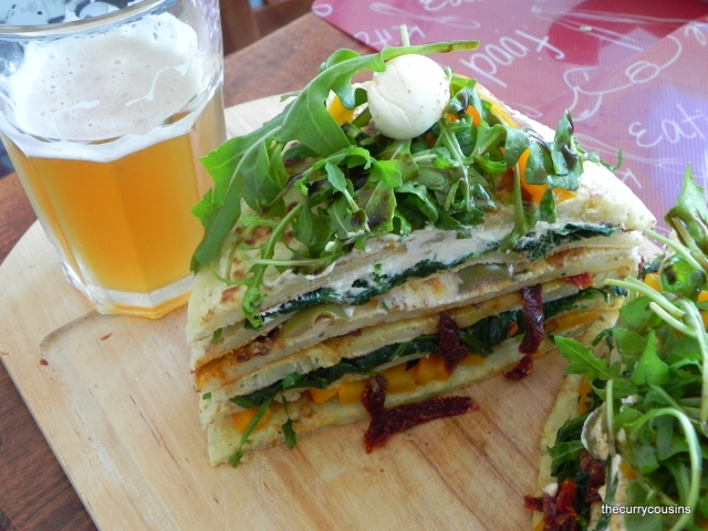 Savory Pancake Tower garnished with Rocket Salad and Bocconcini Cherries