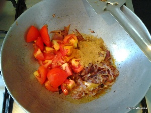 when the onions, ginger garlic is browned,add the tomatoes