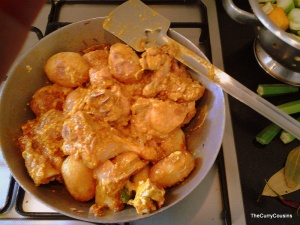 mix the chicken and the potatoes to the masala
